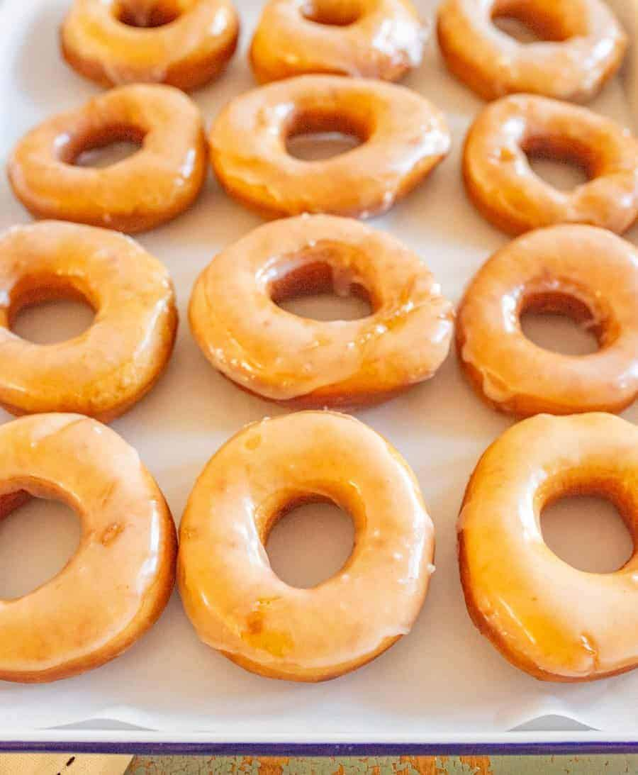 Beth's Famous Glazed Yeast Donuts are light, fluffy, easy to make, and done in just a few hours with a rich and creamy glaze to go on top.