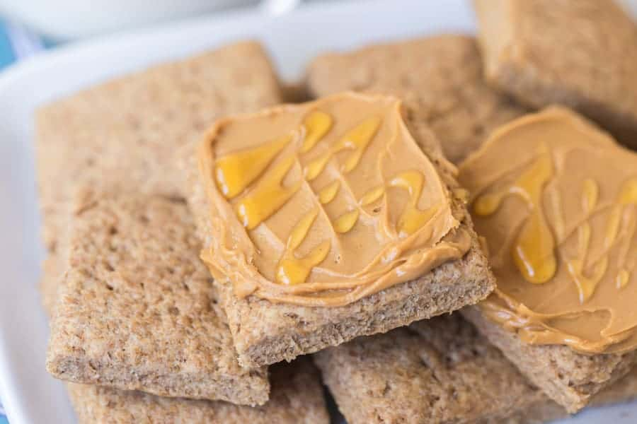 simple homemade graham cracker squares covered in peanut butter and honey