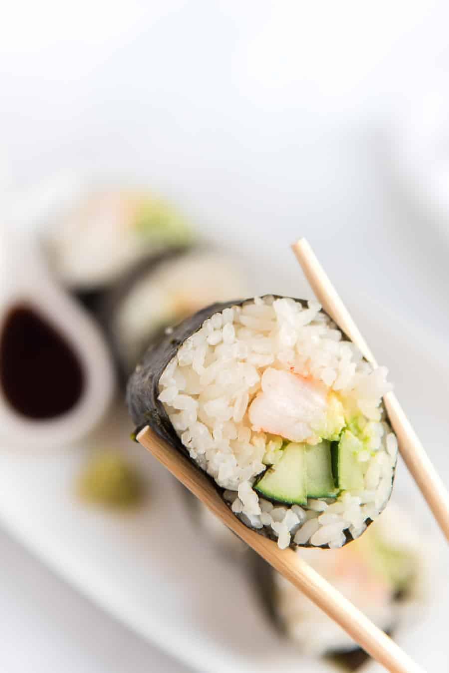 shrimp sushi with chopsticks