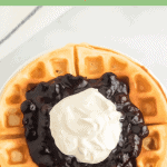 Title Image for Blueberry Topping and a round waffle on a white plate topped with blueberry topping and whipped cream