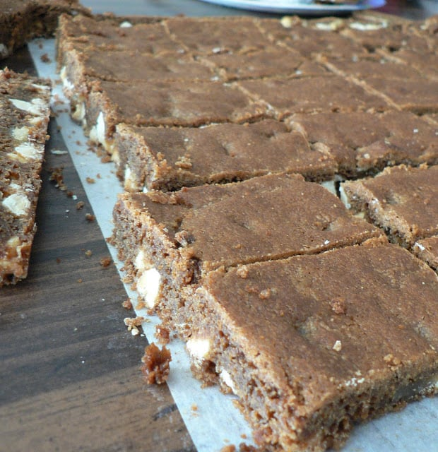 A batch of gingerbread blondies on parchment paper and cut into squares