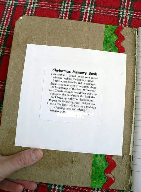 The inside cover of a homemade journal with text describing a Christmas Memory Book