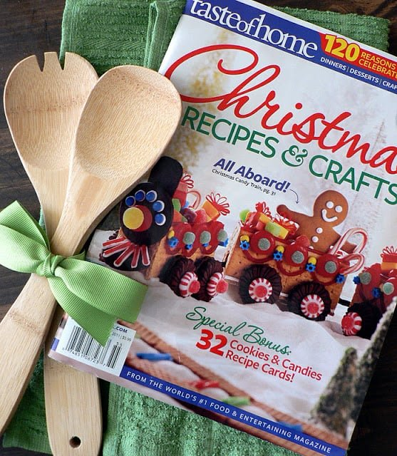 Christmas Recipes and Crafts magazine with two wooden spoons tied with green ribbon