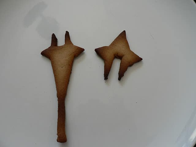 Baked gingerbread star pieces with notches to fit together
