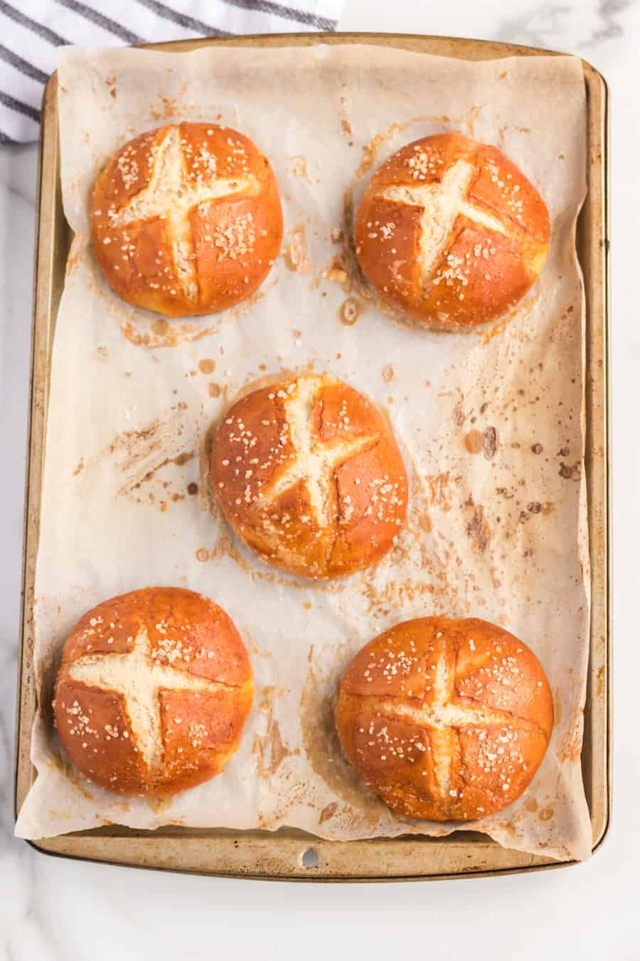 Homemade Pretzel Rolls made with a simple yeast dough that is kneaded until soft, boiled, and then baked into soft and extra chewy pretzel rolls.