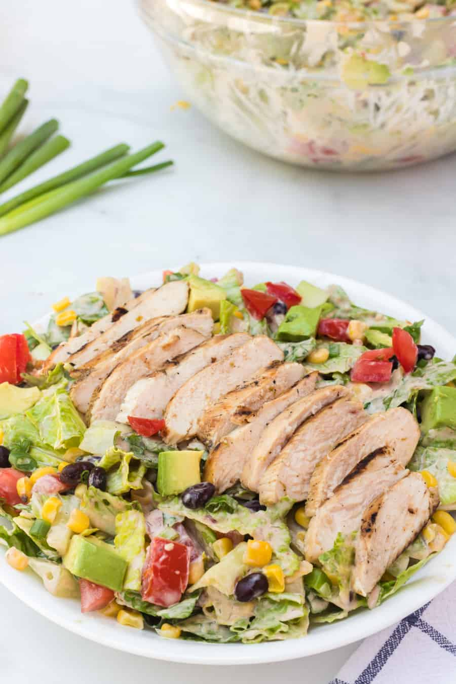 Barbecue ranch chicken salad is the most flavorful salad you'll ever eat, complete with a smoky and sweet dressing, grilled chicken, avocado, tomato, corn, romaine, and a whole lot of other vibrant veggies.