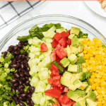 Title Image for Barbecue Ranch Chicken Salad and a bowl of colorful vegetables and black beans for the salad