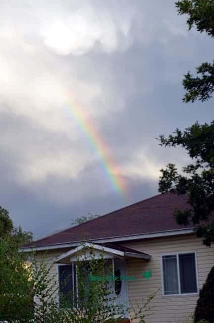 Rainbow behind a yellow house