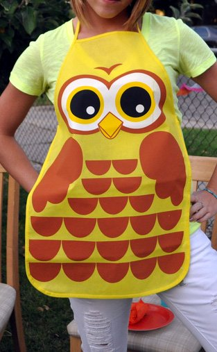 A woman wearing an owl apron