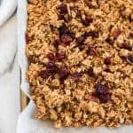 Cinnamon Granola is a simple snack that's bursting with mildly sweet and crunchy goodness, thanks to the oats, honey, shredded coconut, dried cranberries, cinnamon, vanilla, and nuts.