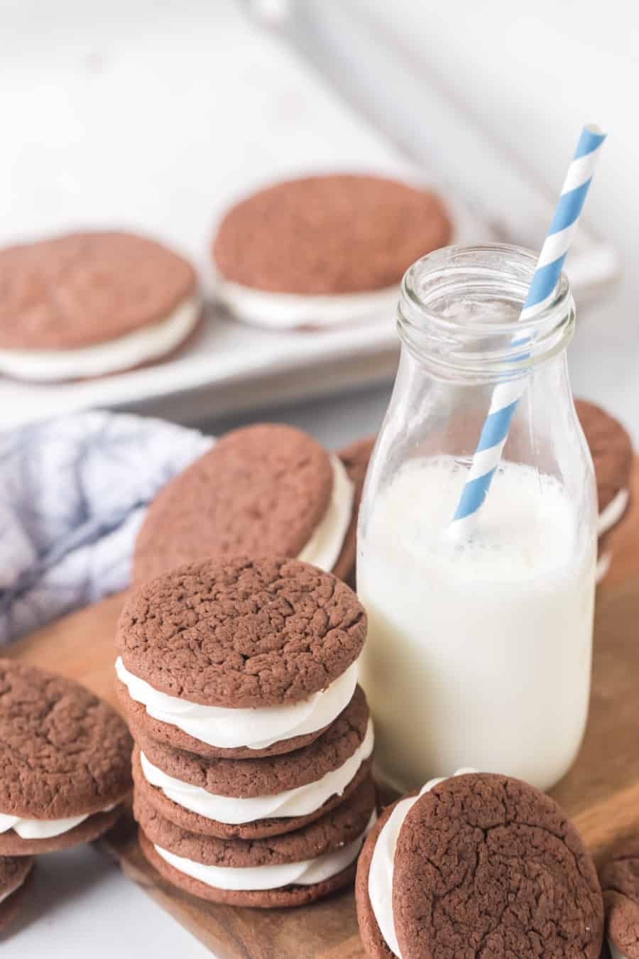 sandwich cookies made with a cake mix next to milk