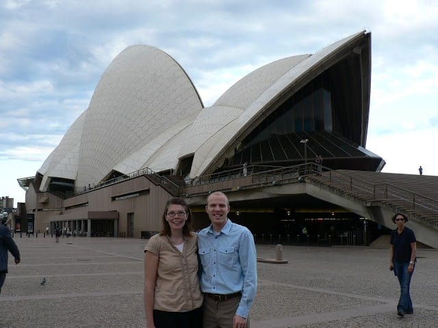 A couple in front of the Sydney Opera House