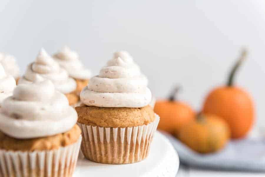 Pumpkin cupcakes with whipped cinnamon icing are perfect bites of fall-inspired sweetness, with just the right amount of pumpkin flavor and warm spices to round them out! #pumpkincupcakes #cupcakerecipe #fallrecipes #pumpkinrecipes #cinnamonfrosting #cupcakes