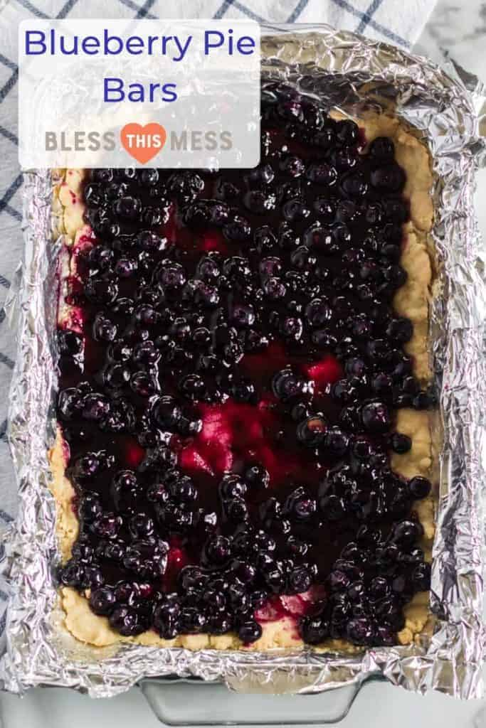 Title Image for Blueberry Pie Bars and a foil-lined rectangular baking dish of blueberry pie bars