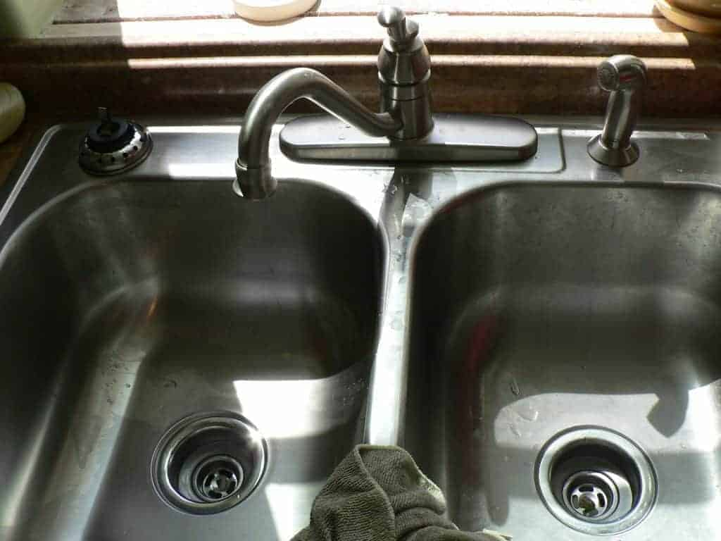 installing a kitchen sink, washing dishes in a bucket, remodeling a kitchen, sink instalation