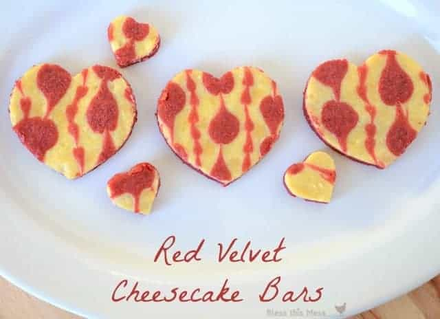 Three large and three small heart shaped cheesecake bars arranged on a white plate.