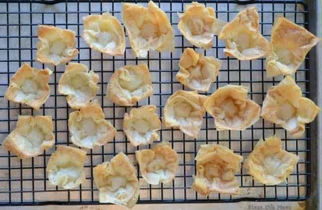 golden mini phyllo cups on a wire cooling rack