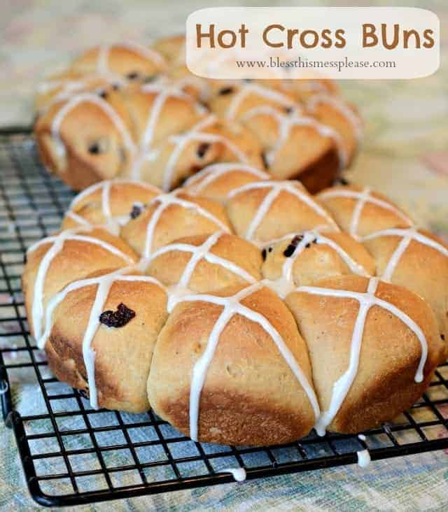 Whole wheat hot cross buns are a light sweet bread with fruit and a simple glaze on top. Think of them as a light and moist cousin of the cinnamon roll without all of the calories.
