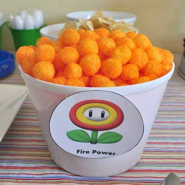 cheese balls in a bowl labeled with a fire flower