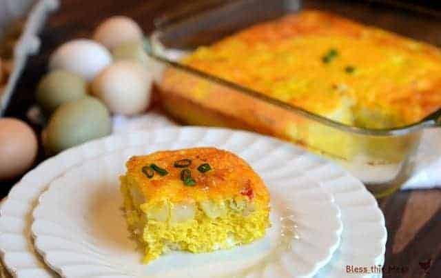 Easy Breakfast Casserole in a glass pan and topped with green onions