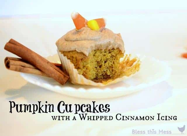 Pumpkin cupcakes with a whipped vanilla icing, A dozen amazing pumpkin recipes collected at www.blessthismessplease.com