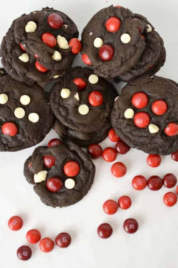 Dark chocolate cookies with red M&M candies and white chocolate chips