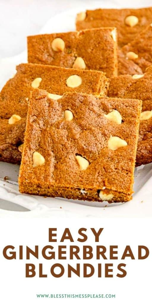 """Side view of a few cut pieces of a blondies with white chocolate chips showing on a plate with the words """"easy gingerbread blondies"""" at the bottom"""