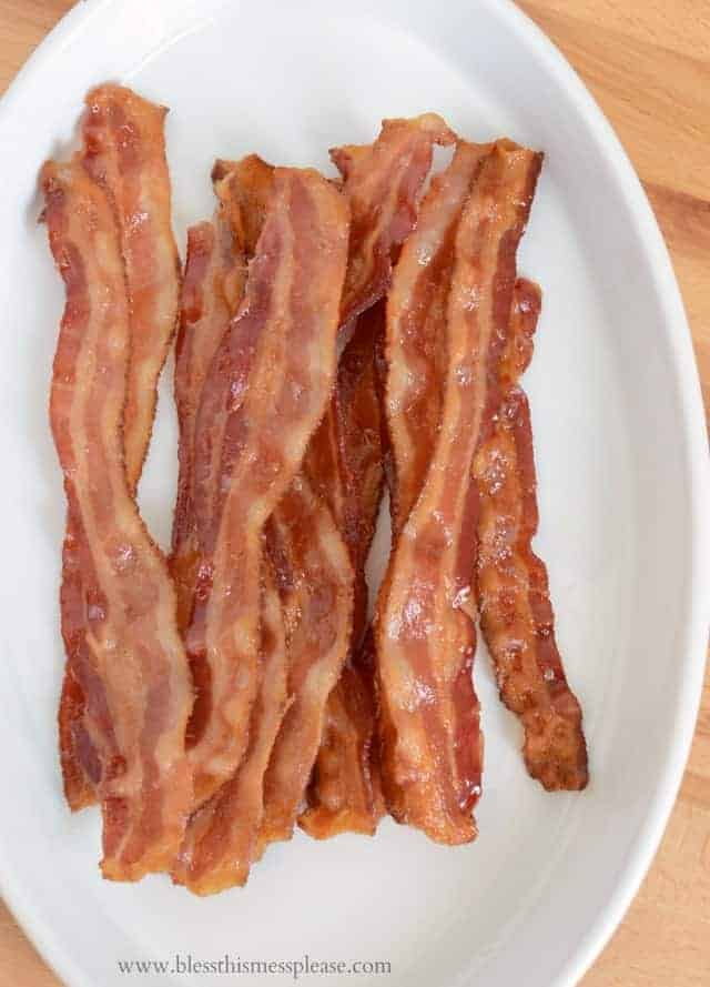 How to make oven baked bacon is simplest and least messy way to make a large or small amount of crispy bacon in the oven.