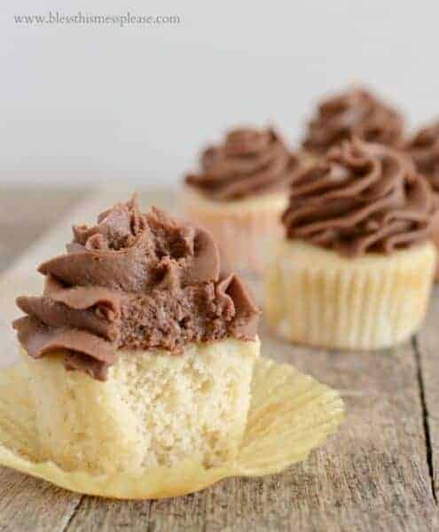 Perfect vanilla cupcakes topped with  homemade whipped milk chocolate frosting are what dreams are made of.
