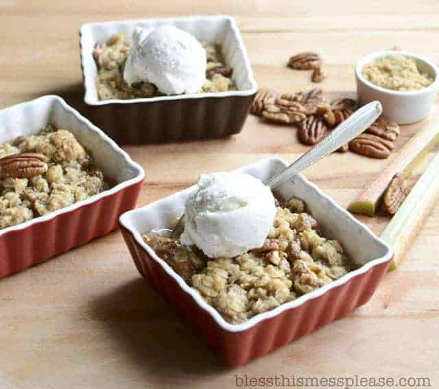Homemade Rhubarb Crisp made with no other fruit and topped with a pecan, butter, and oatmeal topping, baking to perfection, and perfect with ice cream on top.