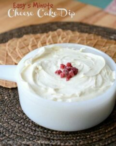 Image of cheese cake dip with raspberry in the middle