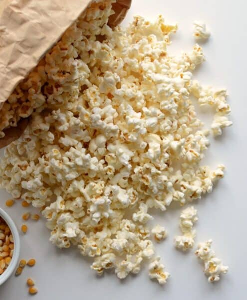 A quick and easy guide on How to Pop Popcorn in the Microwave Using Just a Paper Bag, no oil needed. Making popcorn has never been easier!