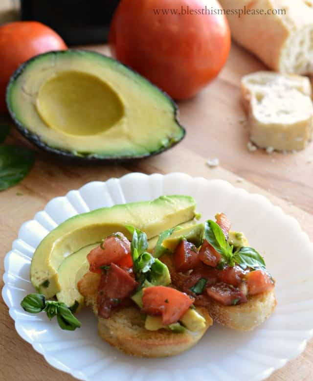 Image of avocado bruschetta with half an avocado