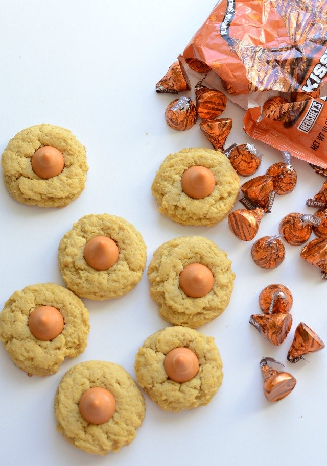 Soft Pumpkin Cookies with Pumpkin Spice Kisses are a twist on the classic peanut butter blossom.