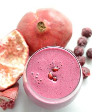 Cup of sour cherry pomegranate detox fruit smoothie