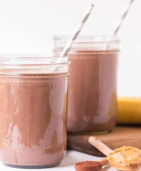 Healthy Chocolate Peanut Butter Smootie in two glasses with paper straws