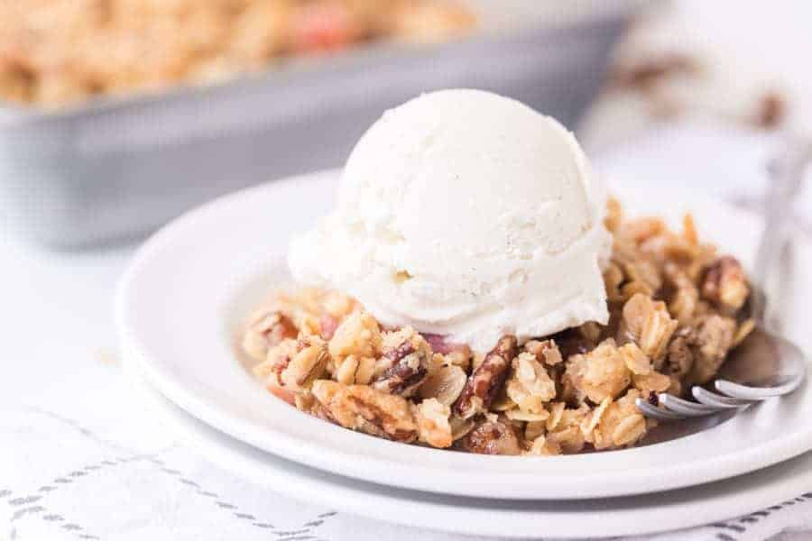 rhubarb crisp with scoop of vanilla ice cream and fork