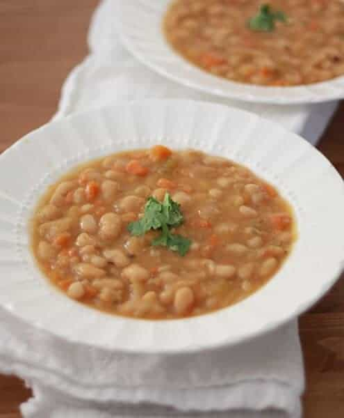 Slow Cooker Vegetable Bean Soup is vegan, gluten-free and perfect for cold and rainy days.