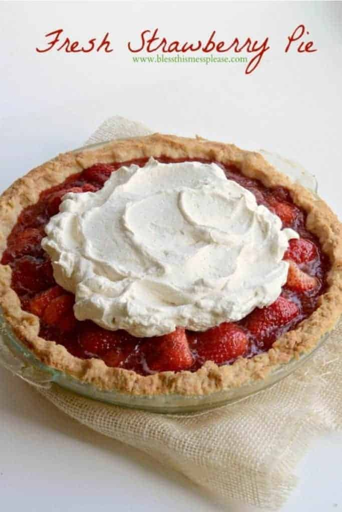 A fresh strawberry pie with whipped cream