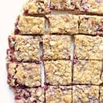 A batch of raspberry bars with streusel topping cut into squares