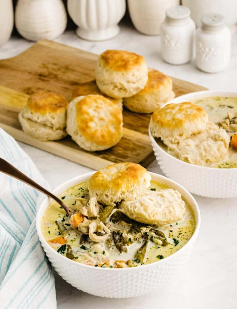 bowls of chicken pot pie with biscuits