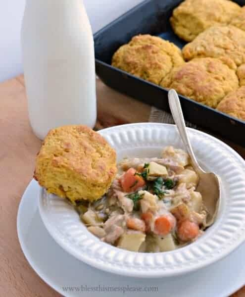Bowl of chicken pot pie with a biscuit