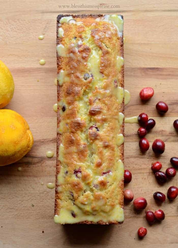 Cranberry Orange Bread is sweet, gorgeous, and perfect for giving!  Made with lots of orange zest, melted butter, and fresh cranberries.