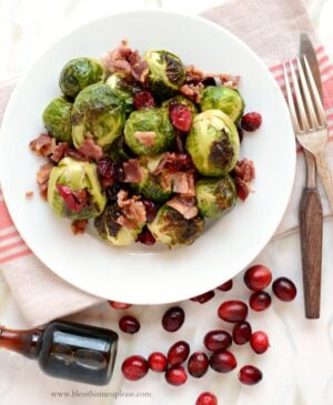 Plate of roasted brussels sprouts with cranberries, bacon and maple syrup
