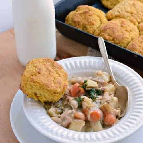 Bowl of chicken pot pie and biscuit