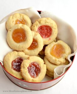 These Shortbread Jam Thumbprint Cookies have a tender, buttery base and a bit of jam in the center. An easy cookie recipe that tastes delicious!