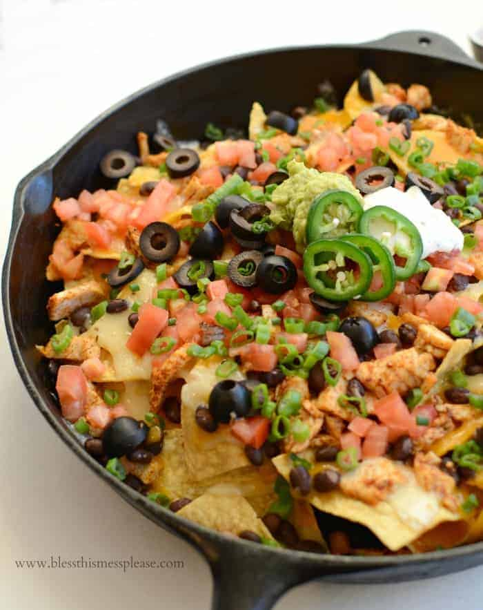 Easy Chicken Skillet Nachos in a cast iron pan