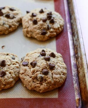 Healthy oatmeal chocolate chip cookies recipe made with honey and whole wheat flour. These cookies are thick, soft, and just sweet enough to satisfy your sweet tooth!