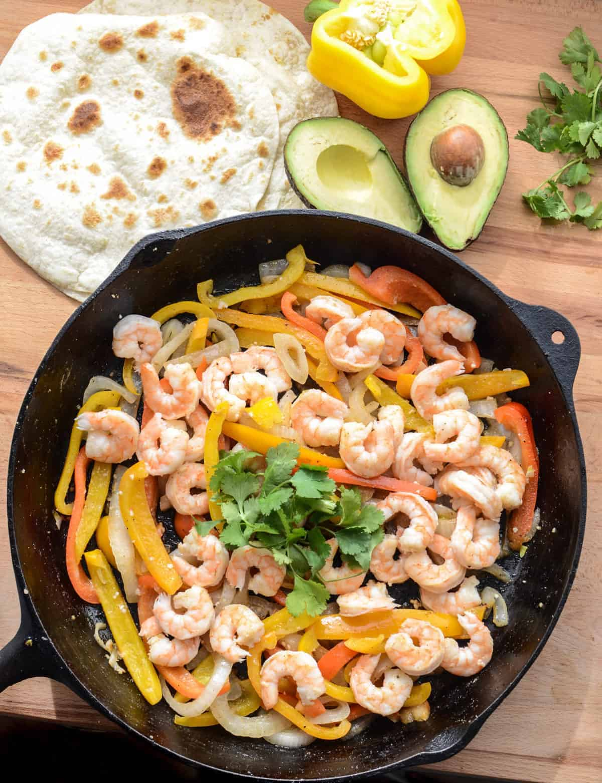 Shrimp fajitas are one of my favorite 20 minute meal ideas that the whole family loves. They come together fast and are full of vegetables!