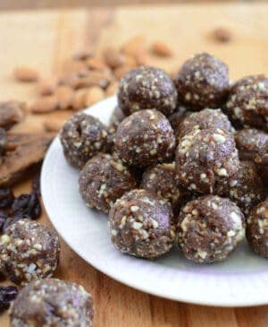 Healthy Cherry Energy Balls are an easy, freezer-friendly whole food dessert that are the perfect afternoon pick me up. Made with dates, almonds, dried cherries, and not much else! These are going to become a staple in your freezer in no time!